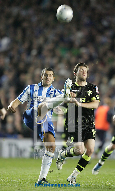 Picture by Paul Terry/Focus Images Ltd..23/9/11.Gary Dicker of Brighton and Jonathan Howson of Leeds during the Npower Championship match at The American Express Community Stadium, Brighton.