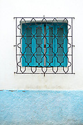 Decorative Moroccan window shutter, Asilah, Northern Morocco, 2015-08-11. <br />