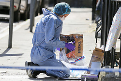 © Licensed to London News Pictures. 01/06/2019. London, UK. A forensic officer collecting the evidence within the crime scene on Seven Sisters Road, near the junction of Vartry Road in Haringey, north London, where a man in his 30s was found suffering from a stab wound to his leg. Police were called by London Ambulance Service just after 3am on Saturday, 1 June 2019. The victims condition in unknown.  Photo credit: Dinendra Haria/LNP
