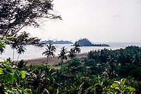 West Sumatra, Padang. Air Manis beach outside Padang. At low water you can walk out to the nearest of these two small islands.