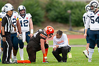 KELOWNA, BC - SEPTEMBER 8:  Cory McCoy #54 of Okanagan Sun kneels on the field with athletic therapist Roy Gillespie against the Langley Rams  at the Apple Bowl on September 8, 2019 in Kelowna, Canada. (Photo by Marissa Baecker/Shoot the Breeze)