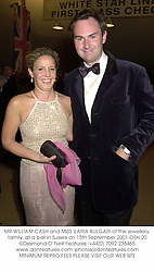 MR WILLIAM CASH and MISS ILARIA BULGARI of the jewellery family, at a ball in Sussex on 15th September 2001.	OSH 20
