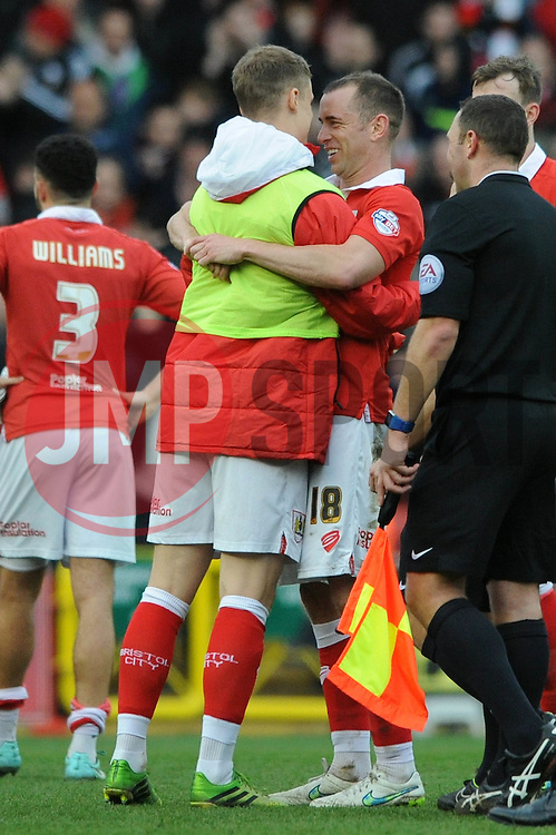 Bristol City's Matt Smith hugs Bristol City's Aaron Wilbraham after the game - Photo mandatory by-line: Dougie Allward/JMP - Mobile: 07966 386802 - 28/02/2015 - SPORT - football - Bristol - Ashton Gate - Bristol City v Rochdale AFC - Sky Bet League One