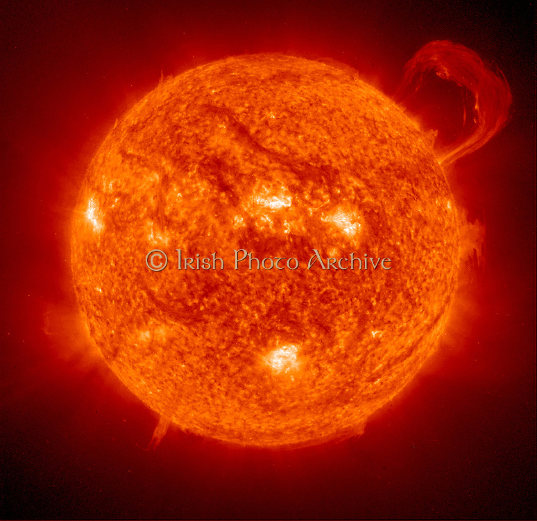 Solar prominence. A prominence is a large, bright feature extending outward from the Sun's surface, often in a loop shape. Prominences are anchored to the Sun's surface in the photosphere, and extend outwards into the Sun's corona.