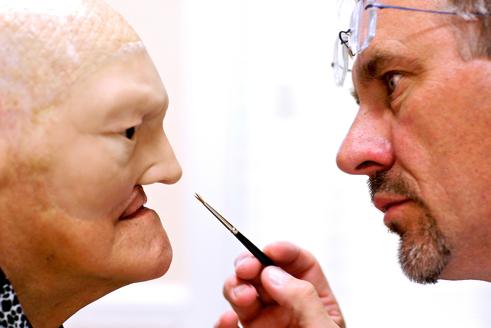 "After weeks of making Amalia Mendoza's prosthetic, David Trainer paints the final details into the silicon skin to help it blend to the rest of Mendoza's face. ""I push myself, I want to make the perfect prosthesis,"" Trainer said. ""It's out there, it's the Holy Grail of what we do."" Greg Kahn/Staff"