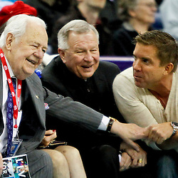 Dec 28, 2012; New Orleans, LA, USA; New Orleans Hornets and New Orleans Saints owner Tom Benson talks with suspended football coach Sean Payton along with New Orleans Archbishop Gregory Michael Aymond courtside during the third quarter of a game at the New Orleans Arena. Mandatory Credit: Derick E. Hingle-USA TODAY Sports
