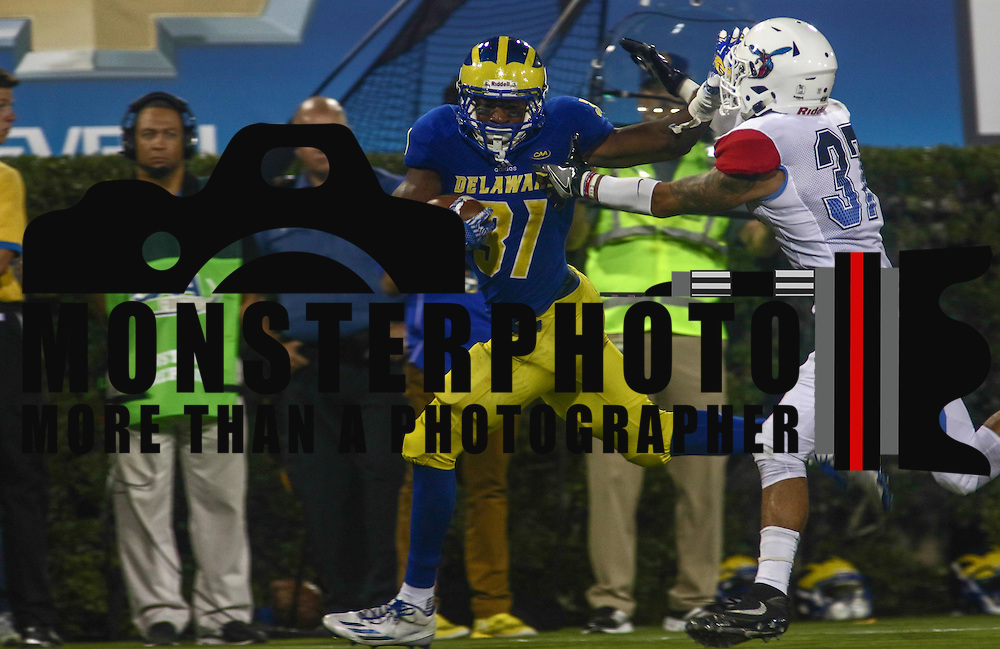 Delaware Running Back WES HILLS (31) fights off a defender during a week one game between the Delaware Blue Hens and the Delaware State Hornets, Thursday, Sept. 01, 2016 at Tubby Raymond Field at Delaware Stadium in Newark, DE.