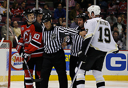 Mar 14, 2007; East Rutherford, NJ, USA;  The linesmen separate New Jersey Devils center Erik Rasmussen (10) and Pittsburgh Penguins defenseman Ryan Whitney (19) during the third period at Continental Airlines Arena in East Rutherford, NJ. Mandatory Credit: Ed Mulholland-US PRESSWIRE Copyright © 2007 Ed Mulholland