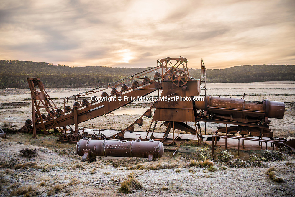 Porvenir, Tierra del Fuego, Chile, June 2017. A gold dredge of a begone era. The windswept pampas of Southern Patagonia and Tierra del Fuego are truly among the one of the world's last frontiers. It was settled by European sheep farmers who have been carving out an existence in this barren land since the 19th century. In a race to control access to 'the end of the world' the Chilean government built a spectacular road, which now functions as the access to some of the last unexplored wildernesses on earth. Welcome to the Darwin Range, Karukinka National Park. Hiking, horseback riding and fly fishing awaits those who are ready for Adventure. Photo by Frits Meyst / MeystPhoto.com