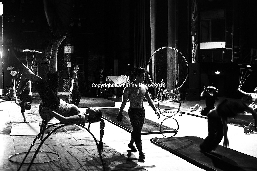 Beijing, Aug.1, 2016 : performers  rehearse for a show in the afternoon inside a theatre in Beijing.<br /> Acrobatic performances belong to Chinas variety arts and have existed for centuries. Acrobats originally were to entertain poor villagers in the countryside. Nowadays it's a profession for young people from the countryside seeking a better life in China's big cities where they lead a life as outcasts. Their monthly income is not enough to participate in social life , let alone to have private lifes. The troupes often live together in basic housing such as dorms and it's difficult to break out.