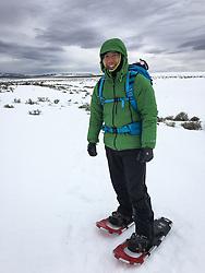 Wildlife photojournalist Noppadol Paothong at work in Wyoming. ©John L. Dengler / DenglerImages.com