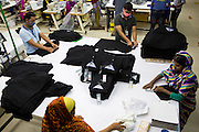 Garment workers folding clothes inside an Epyllion Group garment factory in Bangladesh.