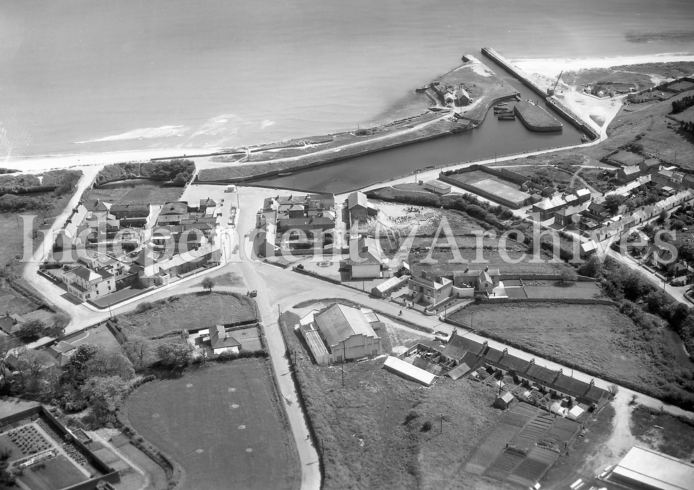 A138 Courtown Harbour.   30/05/58. (Part of the Independent Newspapers Ireland/NLI collection.)<br /> <br /> <br /> These aerial views of Ireland from the Morgan Collection were taken during the mid-1950's, comprising medium and low altitude black-and-white birds-eye views of places and events, many of which were commissioned by clients. From 1951 to 1958 a different aerial picture was published each Friday in the Irish Independent in a series called, 'Views from the Air'.<br /> The photographer was Alexander 'Monkey' Campbell Morgan (1919-1958). Born in London and part of the Royal Artillery Air Corps, on leaving the army he started Aerophotos in Ireland. He was killed when, on business, his plane crashed flying from Shannon.