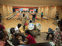People enjoying bowling at a bowling alley in a leisure complex, Mysore.