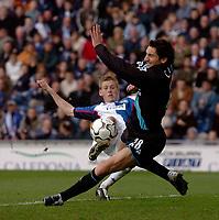 Photo. Glyn Thomas, Digitalsport.<br /> Blackburn Rovers v Leicester City. <br /> FA Barclaycard Premiership. 17/04/2004.<br /> Blackburn's John Stead (L) is blocked by Peter Canero.
