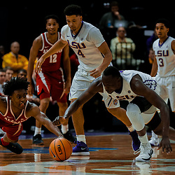 Jan 13, 2018; Baton Rouge, LA, USA; Alabama Crimson Tide guard Collin Sexton (2) and LSU Tigers forward Duop Reath (1) scramble for a loose ball during the second half at the Pete Maravich Assembly Center. Alabama defeated LSU 74-66.  Mandatory Credit: Derick E. Hingle-USA TODAY Sports