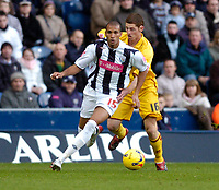 Photo: Leigh Quinnell.<br /> West Bromwich Albion v Burnley. Coca Cola Championship. 18/11/2006. West Broms Diomansy Kamara gets away from Burnleys Chris McCann.