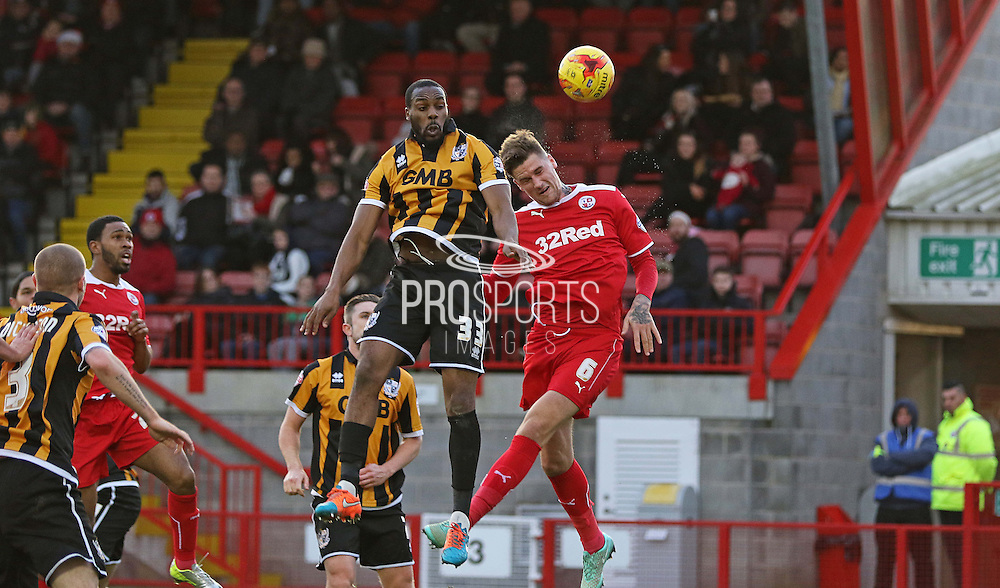Port Vale's Danny N'Guessan heads at goal during the Sky Bet League 1 match between Crawley Town and Port Vale at Broadfield Stadium, Crawley, England on 20 December 2014. Photo by Phil Duncan.