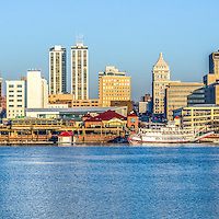 Panoramic Picture of Peoria skyline with downtown city buildings along the Illinois River waterfront and the Spirit of Peoria riverboat. Panorama photo ratio is 1:3.