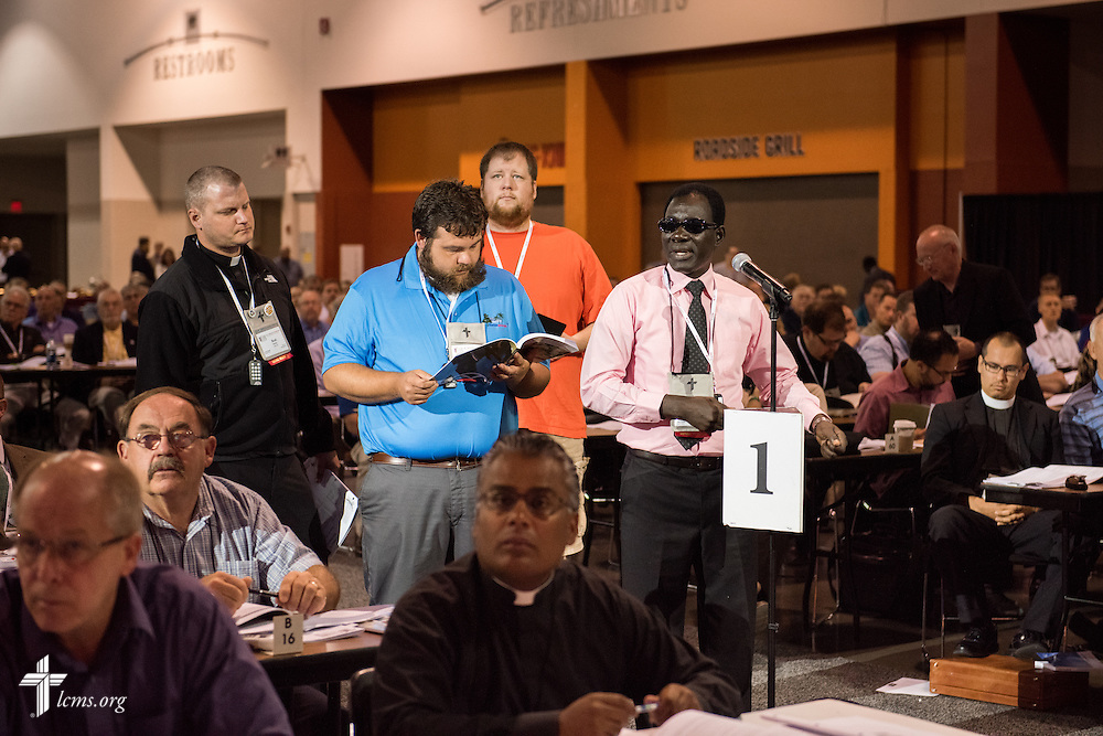 Delegates queue to speak Tuesday, July 12, 2016, at the 66th Regular Convention of The Lutheran Church–Missouri Synod, in Milwaukee. LCMS/Frank Kohn