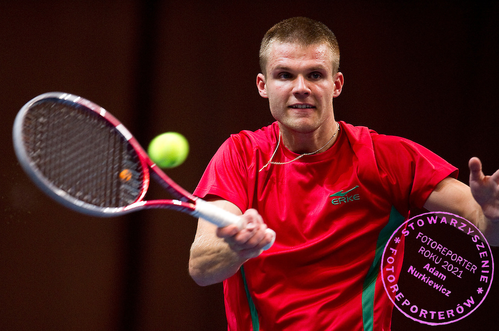 Dzmitry Zhyrmont of Belarus competes at man's singles match at third day during the BNP Paribas Davis Cup 2012 between Poland and Belarus at MOSiR Hall in Lodz on September 16, 2012...Poland, Lodz, September 16, 2012..Picture also available in RAW (NEF) or TIFF format on special request...For editorial use only. Any commercial or promotional use requires permission...Photo by © Adam Nurkiewicz / Mediasport