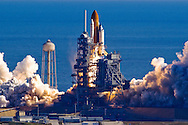 Space Shuttle Columbia lifts off of launch pad 39-A at Kennedy Space Center January 16, 2003. The research mission which will host over 80 experiments conducted by the crew which includes Ilan Ramon of the Israel Space Agency. (Photo by Matt Stroshane / Getty Images)