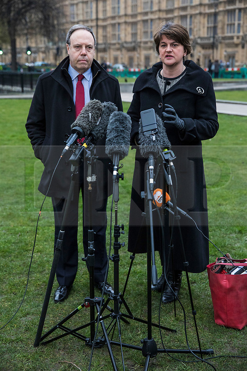 © Licensed to London News Pictures. 21/02/2018. London, UK. DUP Leader ARLENE FOSTER (R) and DUP Deputy Leader NIGEL DODDS (L) give a statement to the press after meeting with Prime Minister Theresa May. Photo credit: Rob Pinney/LNP