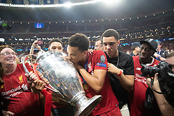 MADRID, SPAIN - SATURDAY, JUNE 1, 2019: Liverpool's Trent Alexander-Arnold celebrates with the trophy and his family after the UEFA Champions League Final match between Tottenham Hotspur FC and Liverpool FC at the Estadio Metropolitano. Liverpool won 2-0 to win their sixth European Cup. (Pic by Peter Makadi/Propaganda)