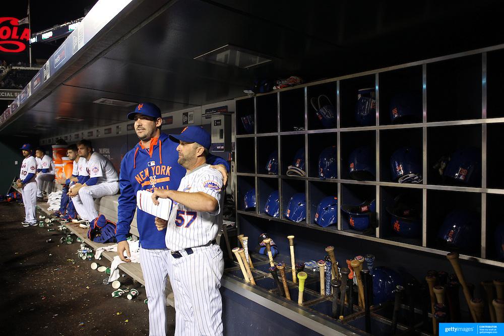 Matt Harvey, (left), New York Mets, with hitting coach Kevin Long, in the dugout during the New York Mets Vs Atlanta Braves MLB regular season baseball game at Citi Field, Queens, New York. USA. 22nd September 2015. Photo Tim Clayton