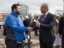 "© Licensed to London News Pictures. 05/04/2014. London, UK. Mayor of Tower Hamlets, Lutfur Rahman speaks to local residents during a community walkabout in Stepney, East London on 5th April 2014 to canvas for the upcoming Mayoral election. Communities Secretary, Eric Pickles yesterday sent inspectors to start an audit of Tower Hamlets council and the Rahman administration following allegations of fraud and financial mismanagement, also reported by BBC's Panorama programme this week. Mayor Lutfur Rahman denies all allegations, which he calls ""Panorama lies"". Photo credit : Vickie Flores/LNP"