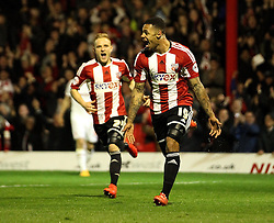Brentford's Andre Gray celebrates - Photo mandatory by-line: Robbie Stephenson/JMP - Mobile: 07966 386802 - 08/05/2015 - SPORT - Football - Brentford - Griffin Park - Brentford v Middlesbrough - Sky Bet Championship
