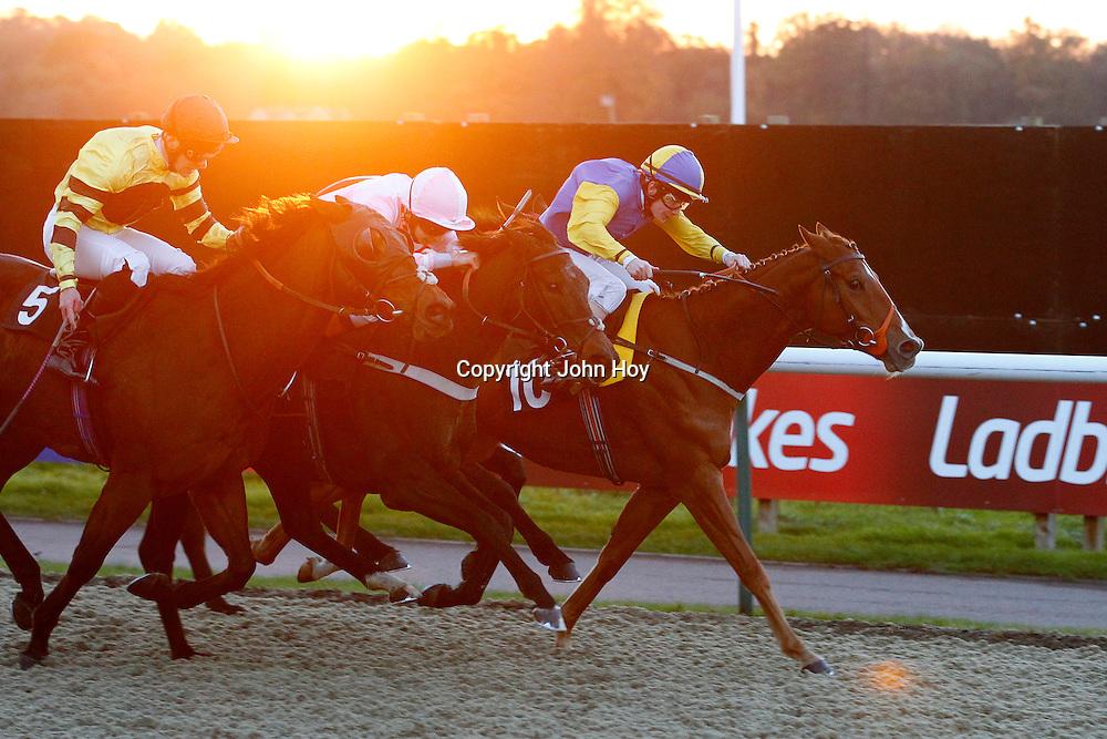 Clock Opera and Louis Stewart winning the 3.45 race
