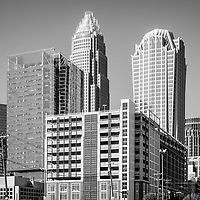 Charlotte North Carolina black and white photo with downtown city buildings Bank of America Corporate Center and Hearst Tower. Charlotte is a major city in the Eastern United States of America.