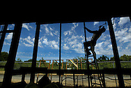 Gordon Rice a Glazing Specialist pounds a nail as he frames for window in the old train depot. For years, Loomis has been trying to figure out what to do about a historic train depot that has been in disrepair. The town finally got some money for a rehab project. On Tuesday, workers are expected to be doing work on the roof. We need some shots of the repair work. The foreman in charge is named Nathan.That's a first name. Unknown last name. Note: The work on the roof will last three days, the town says. So if no photogs are available on Tuesday, then Wednesday is still an option to send someone.
