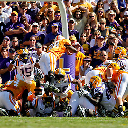 Oct 2, 2010; Baton Rouge, LA, USA; Tennessee Volunteers running back Tauren Poole (28) dives over the pile for a touchdown against the LSU Tigers during the first half at Tiger Stadium.  Mandatory Credit: Derick E. Hingle