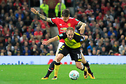 Burton Albion striker Luke Varney (16) and Manchester United defender Matteo Darmian (36) battle for the ball during the EFL Cup match between Manchester United and Burton Albion at Old Trafford, Manchester, England on 19 September 2017. Photo by Richard Holmes.