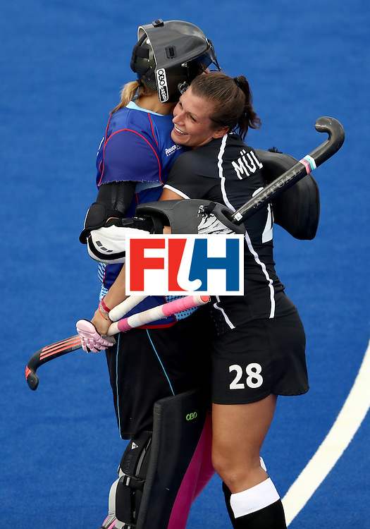 RIO DE JANEIRO, BRAZIL - AUGUST 08:  Kristina Reynolds #32  hugs Julia Muller #28 of Germany after defeating New Zealand 2-1 during a Women's Pool A match on Day 3 of the Rio 2016 Olympic Games at the Olympic Hockey Centre on August 8, 2016 in Rio de Janeiro, Brazil.  (Photo by Sean M. Haffey/Getty Images)