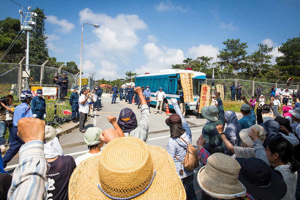 OKINAWA, JAPAN - AUGUST 19 : Anti U.S base protesters raise their fists in the air to protest against the construction of helipads in front of the main gate of U.S. military's Northern Training Area in the village of Higashi, Okinawa Prefecture, on August 19, 2016. Japanese government resume construction of total six helipads in a fragile ten million year old Yanbaru forest that is home to endemic endangered species such as the Okinawan rail and Okinawa wood pecker. (Photo by Richard Atrero de Guzman/NURPhoto)