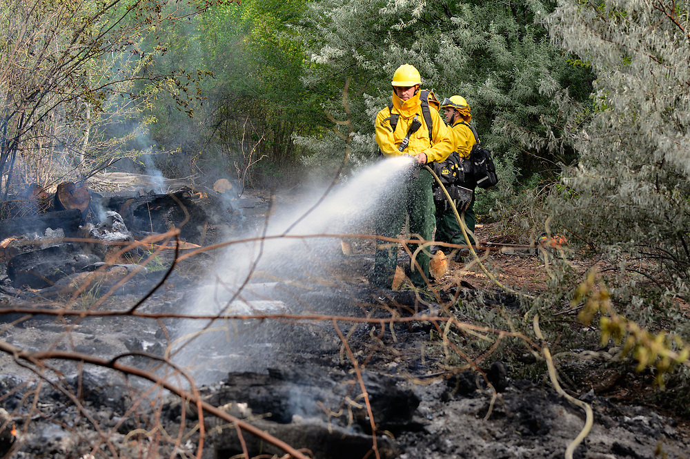 jt060617b/ a sec/jim thompson/ AFD Wildland firefighters hit the hot spots on a bosque fire  Tuesday morning.  AFD is calling it the Tingley Fire is less than a 1/4 acre in size and they have ruled out natural causes. Tuesday June. 06, 2017. (Jim Thompson/Albuquerque Journal)