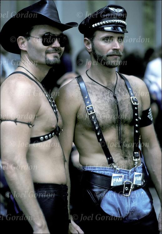 Gay couple in S&M paraphenalia @ Gay Pride Parade,  NYC