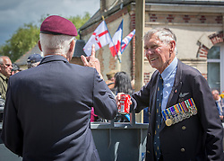 © Licensed to London News Pictures. 05/06/2014.  D Day Veterans take some time out as they attend a service at  Pegasus Bridge for the 70th Anniversary of the D Day landings in Normandy.  Photo credit : Alison Baskerville/LNP