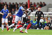 Grimsby Town midfielder Mitch Rose(8) and Oldham Athletic midfielder Christopher Missilou (17) during the EFL Sky Bet League 2 match between Grimsby Town FC and Oldham Athletic at Blundell Park, Grimsby, United Kingdom on 15 September 2018.