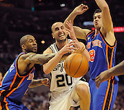 New York Knicks Wilson Chandler (L) and Danilo Gallinari, #8 of Italy (R) defend against San Antonio Spurs Manu Ginobili of Argentina during the first half of their game at the AT&T Center in San Antonio, Texas,  10 March, 2010.