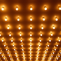 Picture of theater lights on a movie theater entrance. Image is vertical, high resolution and is available as a stock photo or print.