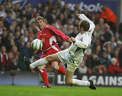 LIVERPOOL, ENGLAND - SUNDAY MARCH 27th 2005: Liverpool Legends' Kenny Dalglish sends in a cross against the Celebrity XI during the Tsunami Soccer Aid match at Anfield. (Pic by David Rawcliffe/Propaganda)