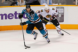 May 16, 2010; San Jose, CA, USA;  San Jose Sharks center Joe Thornton (19) skates past Chicago Blackhawks right wing Marian Hossa (81) during the first period of game one of the western conference finals of the 2010 Stanley Cup Playoffs at HP Pavilion.  Chicago defeated San Jose 2-1. Mandatory Credit: Jason O. Watson / US PRESSWIRE