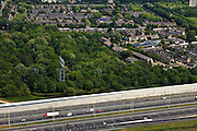 Nederland, Utrecht, Maarssen, 13-05-20011; de nieuwe en verbrede Rijksweg A2 ter hoogte van Maarssen met nieuwe geluidsscherm, van beton en aluminium(architect Alette van Aalst). Op het tweede plan Maarssenbroek.The new (widened) highway A2 at near Maarssen. New noise barrier, made of concrete and aluminum (architect Alette van Aalst). Second plan .luchtfoto (toeslag), aerial photo (additional fee required) foto/photo Siebe Swart