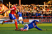 Chris Barker Fouls Calvin Andrews during the The FA Cup match between Aldershot Town and Rochdale at the EBB Stadium, Aldershot, England on 7 December 2014.