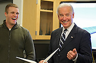 Iowa State student Jared Juel laughs as Vice President Joe Biden tells a joke while on a tour of the Make to Innovate lab at Iowa State University in Ames, Iowa on Thursday, March 1, 2012.