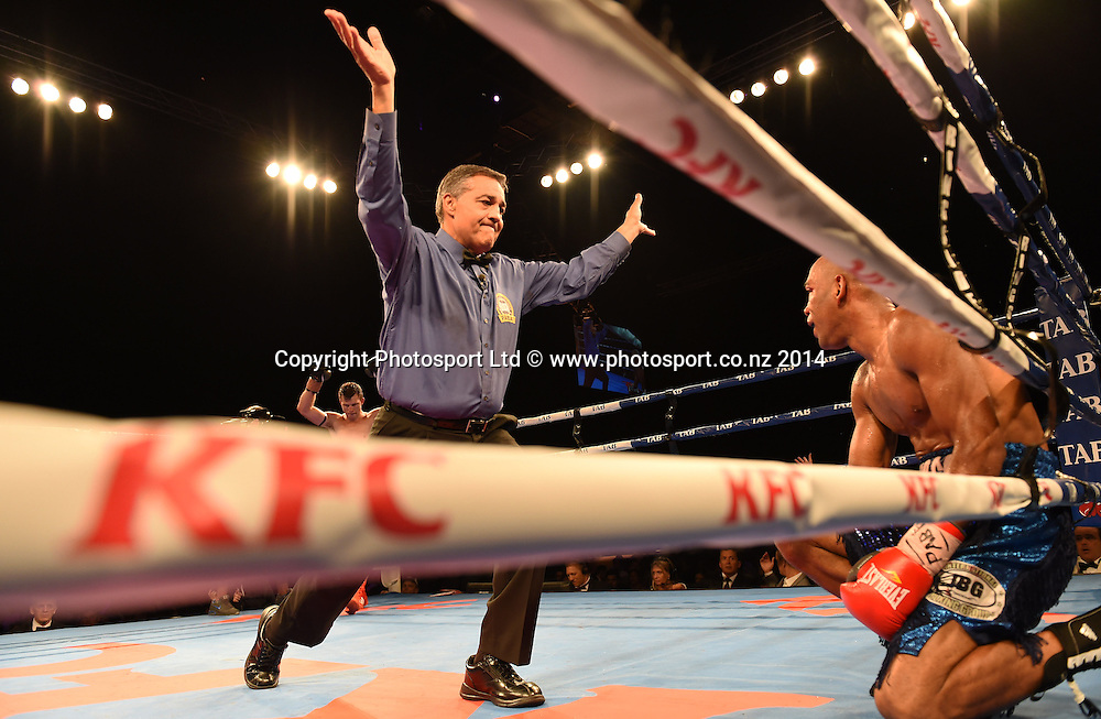 Referee Brad Vocale counts out Robson Assis. KFC Fight For Life Boxing by Duco Events at the Claudelands Arena in Hamilton. New Zealand. Saturday 6 December 2014. Photo: Andrew Cornaga/www.photosport.co.nz.